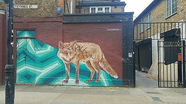 Foxes are a frequent subject for street art - this one on Toynbee Street