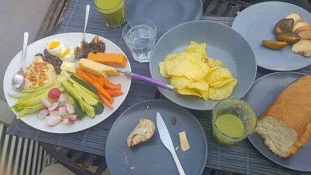 Hummus with veggies, cheese, a hard boiled egg and some fruit